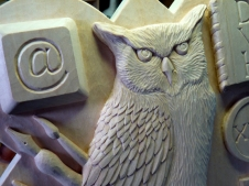 Detail of the owl and 'at' key.