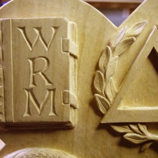 The closed book with the initials WRM.