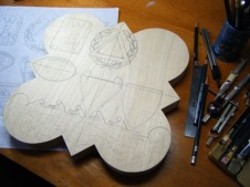 The design is tranferred onto the basswood.