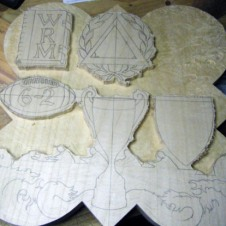 The background is routered out to begin the carving process.