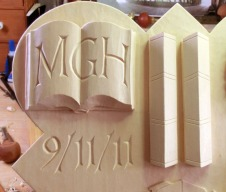 Detail of the open book with the initials MGH.