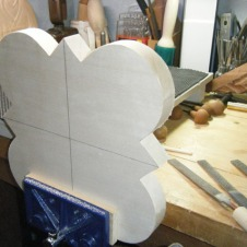 Filing the edges of the carving blank.