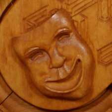 The comedy mask with stained finish.