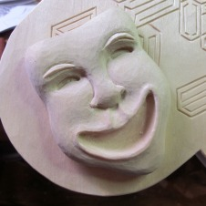 Detail of the comedy mask.