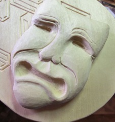 Detail of the tragedy mask.