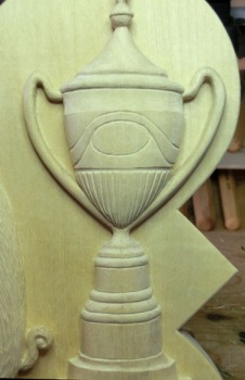 The Princess Elizabeth Challenge Cup which sits on top of a shield featuring an emblem from the Henley-on-Thames coat of arms – representing the win at Henley for the boys' crew team.
