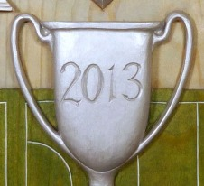 A sample of the painted finish on the 2013 plaque – the central element representing the Hugh Camp Cup.