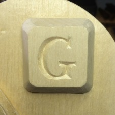 "The upper right corner features the letter ""G"" on a computer keyboard key – representing the launch of the Google search engine on 9/4/1998."