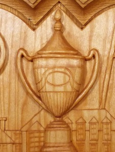 A detail of the stained finish of the Princess Elizabeth Challenge Cup.