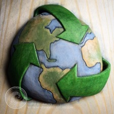 Painted detail on the earth/recycling symbol.