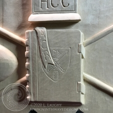 Lower center: A closed book with the School shield, with a bookmark bearing the initials A C R, represents the service of Amy C. Richards as Interim Rector.